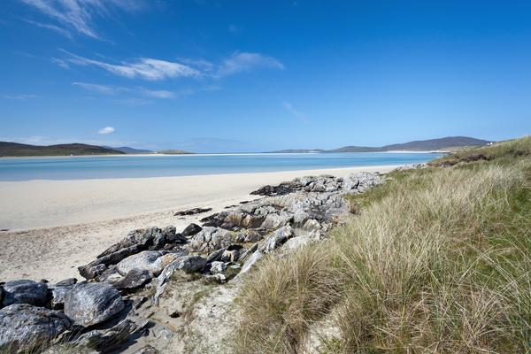 White sandy beach with green-blue waters lapping onto the shore at Luskentyre Beach, Isle of Harris, Western Isles