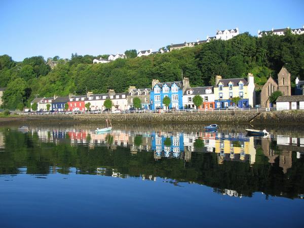 Colourful painted houses reflected in the sea, Tobermory, Isle of Mull
