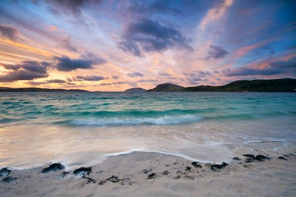 Colorful dawn on a white sandy beach, Vatersay beach, Outer Hebrides