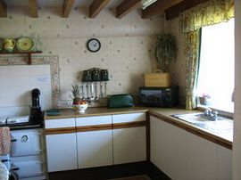 Kitchen with Rayburn cooker in Farmhouse