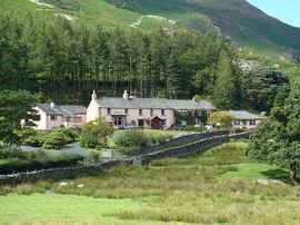 Manesty Holiday Cottages - Manesty from the farm fields to the East