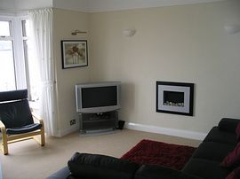 Lounge with leather suite and widescreen TV