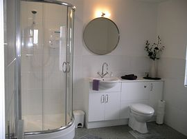 Bathroom with seperate shower and corner bath