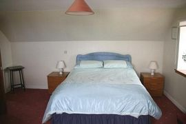 Large room with en-suite and king size bed. Views to font to the sea and to the side to the golf course and river.