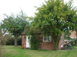 Laburnum Lodge - The Lodge nestled under the Laburnum tree