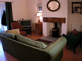 Gelston Lodge Holiday Cottages - cosy living room
