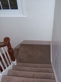 stairs up to bathroom and bedrooms