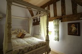 One of the four poster bedrooms