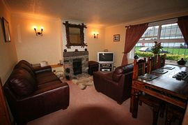 The Cottage at Loch Tay - Comfortable Living Room With Open Fire