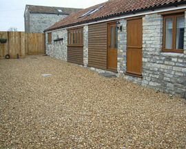 Pitts Farm Holiday Cottages - Stable Cottage entrance and communal courtyard