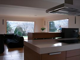 Part of kitchen, seating area.
