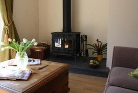 Sitting room, with wood burner and cofy sofas.