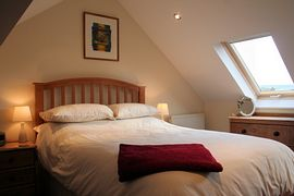 Double bedroom built into the rafters with roof lights which provide a warm natural glow to the room.