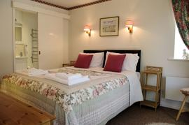 The double bedroom has en-suite shower room with washbasin, toilet and heated towel rail.