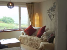 Open-plan sitting room with views of Glen Affric