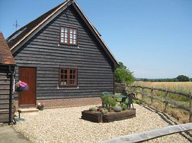The Hayloft - View of paved garden area and end of Hayloft building