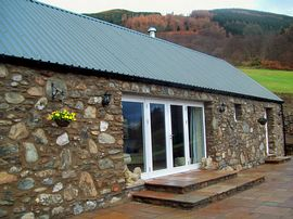 Briar Steading - Stone front and patio windows