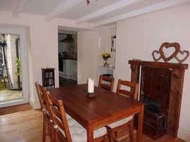 The Dining Room that easily seats four with original feature bread oven