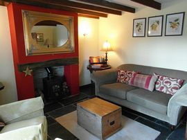 Cosy sitting room with logburner