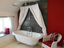 Bathroom with rolltop bath