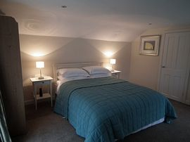 The Coach House - One of the bedrooms