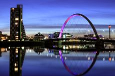 The River Clyde in Glasgow at night, showing the Squinty Bridge © fujji/shutterstock