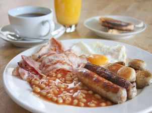 Full English Breakfast with bacon, sausage, eggs and baked beans.