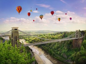 Hot air balloons flying over Clifton suspension bridge