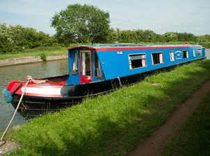 Narrowboat moored up by the towpath on the Grand Union Canal
