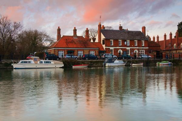 Boats moored in front of historic pub in Abingdon, Oxfordshire