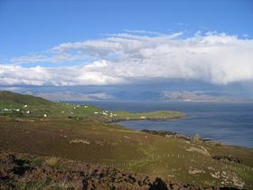 May 2007. Scenery while doing the walk to the Point of Sleat. Houses of the village of Aird . Looking across the Sound of Sleat. © Joanne Brockman