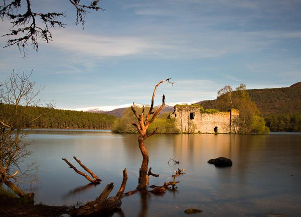 Evening view of loch an eilean castle, in the Cairngorms