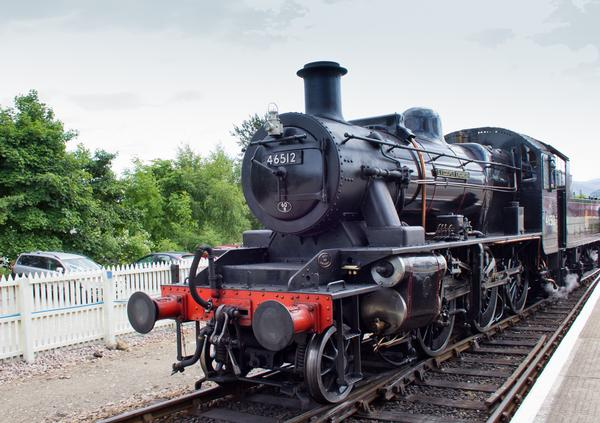 Large black Ivatt 46512 Class steam engine on the Strathspey Railway
