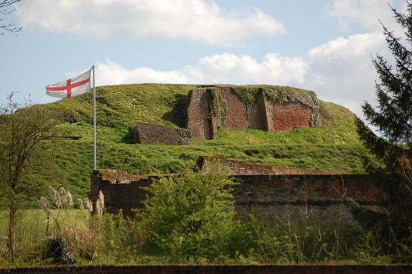 The ruins of Basing House, with English flag in foreground