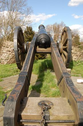 A cannon pointing from the ruins of Basing House in Old Basing, Basingstoke in Hampshire