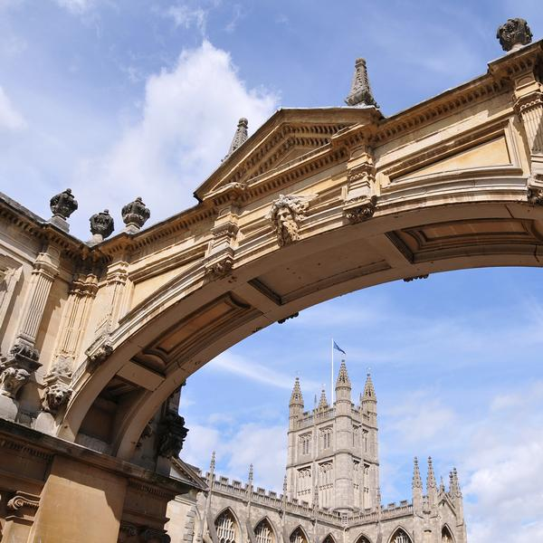 Bath Abbey seen through arch of stone bridge