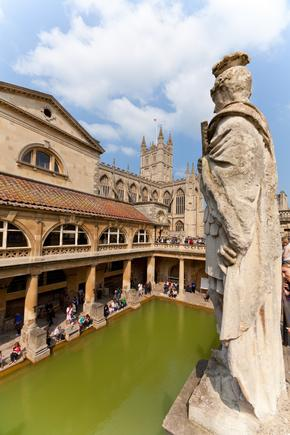 Elevated view of Roman Baths with statue in foreground