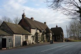 The Waggon & Horse pub Beckhampton, with Silbury Hill in the background. © Keith Wills