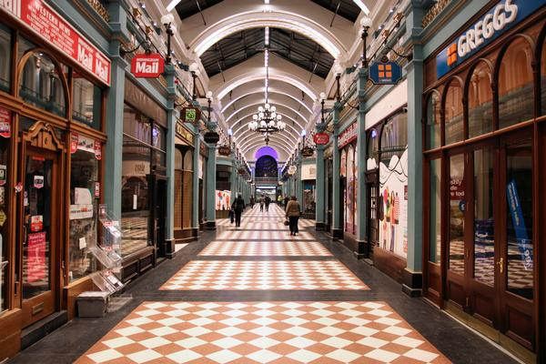 Arched roof and checkerboard tiled floor of Great Western Arcade, Birmingham