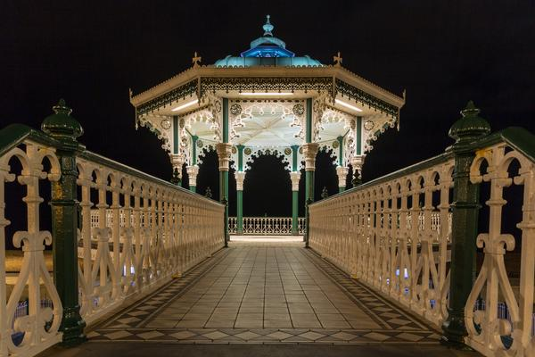Ornate Brighton Bandstand illuminated at night