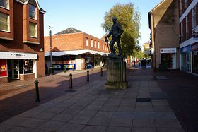 Bromsegrove main shopping street showing the statue to A.E. Housman © tj potter
