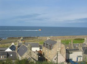View from end of Land St  showing lifeboat in the sea © Jane Jamieson
