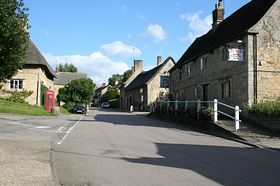 The main street in Bulwick with the Queen's Head public house, and the village stores. © Roger Gurney