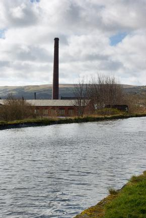 Old disused cotton spinning mill beside the canal in Burnley, Lancashire, England