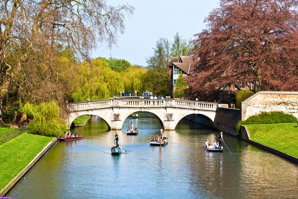 View of bridge and people in punts on the River Cam at King