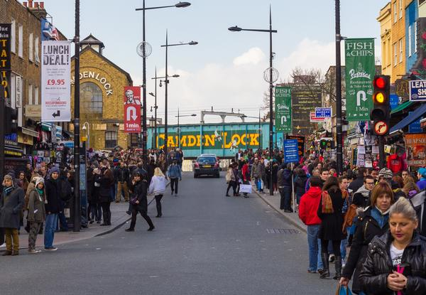 Busy shopping street in Camden Town during the day, with Camden Lock ahead