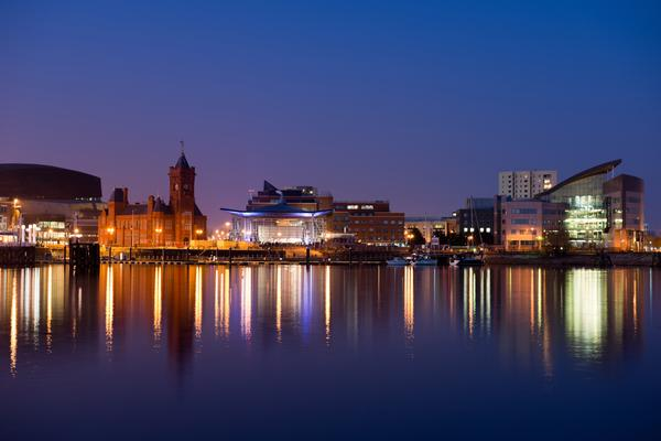 Cardiff Bay at night with lights reflecting in the sea