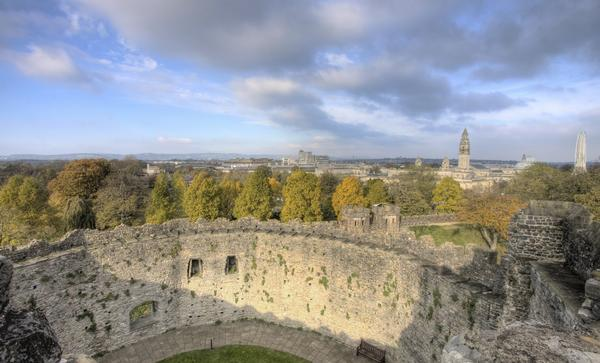 Walls of Cardiff Castle with view to city in the distance