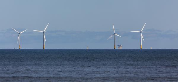 Wind turbines off shore at Colwyn Bay, Wales