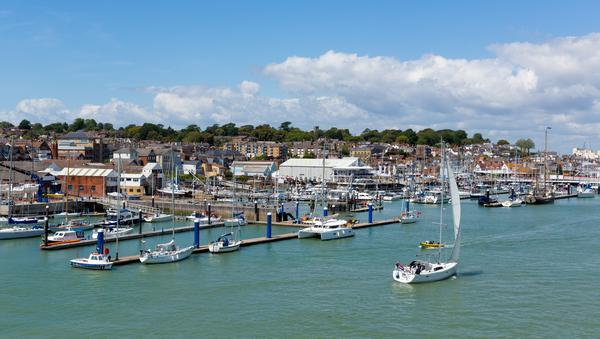Boats in Cowes Harbour, Isle of Wight on a summer